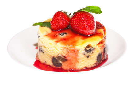 Cheesecake with fresh strawberries on white plate closeup photo