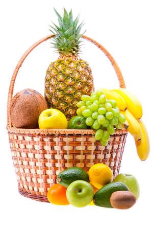 wicker basket full of ripe fruit photo