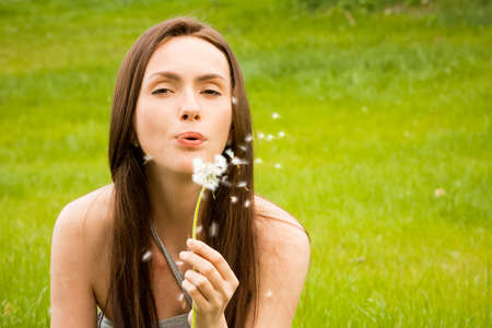 Girl with dandelion on green field Stock Photo - 9799015