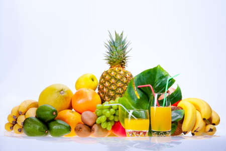 Assortment of fresh fruits and coconut juice photo