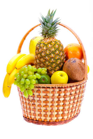wicker basket full of the ripe fruit photo