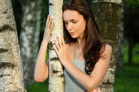 european white birch: Girl in a birch grove Stock Photo