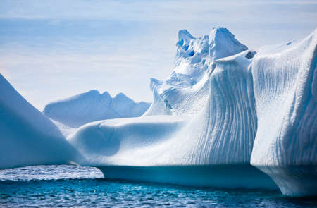 Antarctic iceberg in the snow. Beautiful winter background. Imagens