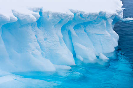 Antarctic glacier in the snow. Beautiful winter background.