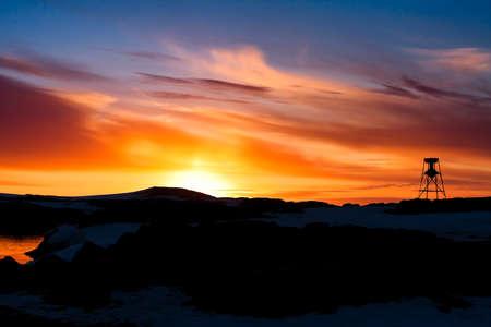Summer  sunset in Antarctica.  Beautiful winter background. photo