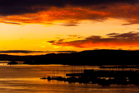 Cloudy orange sunset over sea. Beautiful landscape Stock Photo - 10632821
