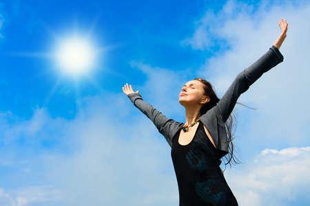 Beautiful young woman under blue sky. Portrait photo