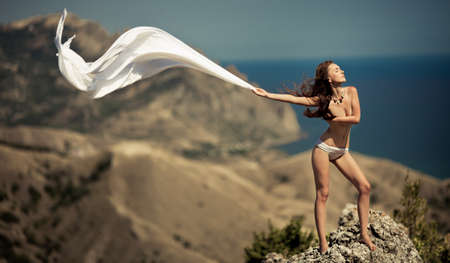 beauty woman on the rock white tissue photo