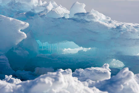 Antarctic Glacier with cavities. Beautiful winter background. Stock Photo