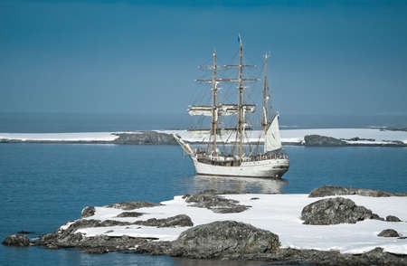 brigantine: Sailing ship among the icebergs in Antarctica Stock Photo