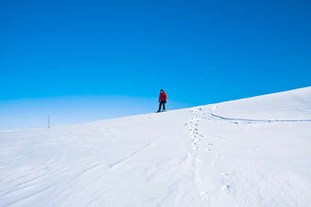 Man moves on snowboard. Glacier in background. Antarctica photo