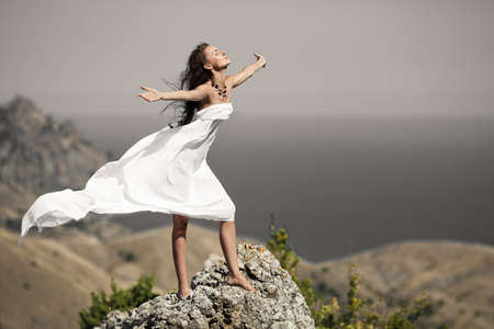wind dress: beauty woman on the rock in white tissue
