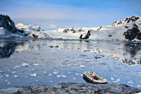 boat in Antarctic waters, mountains on the background Stock Photo - 12107548