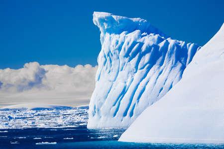 Beautifull big antarctic iceberg in the snow photo