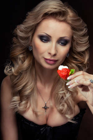 sexy girl with ripe strawberry photo