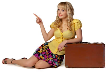 portrait of a beautiful girl with a suitcase on a white background