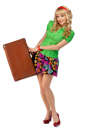 portrait of a beautiful girl with a suitcase on a white background photo