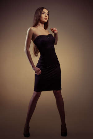 portrait of a beautiful girl in black dress photo