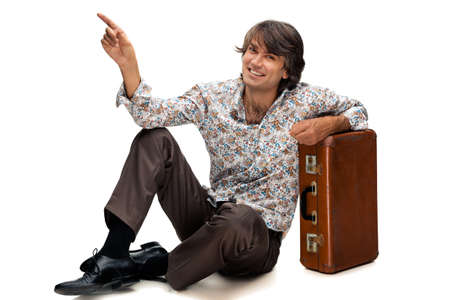 portrait of man with a suitcase on a white background Stock Photo