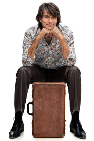 portrait of man with a suitcase on a white background photo