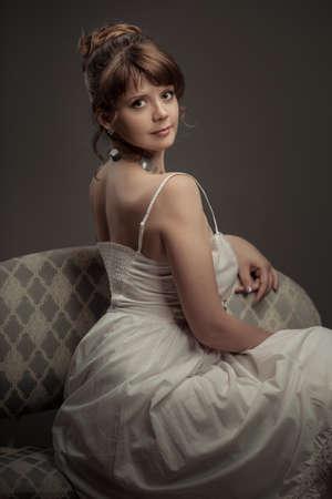 girl sitting on the retro sofa