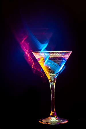martini splash: colourful coctail on the black background