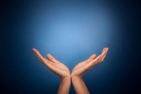Hands holding on blue background photo