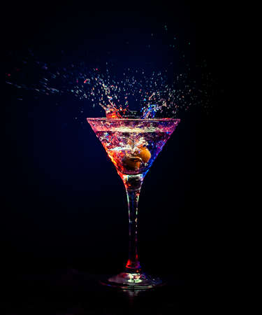 martini splash: fresh coctail on the black background Stock Photo