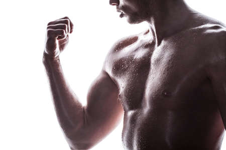 Handsome athlete on a white background Stock Photo