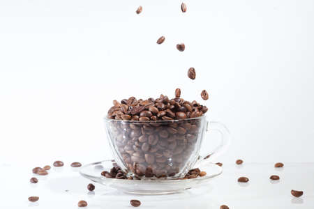 coffeetime: Coffee cup on with beans, on white background with falling beans