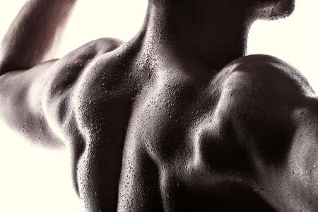 muscle shirt: Atleta hermoso sobre un fondo blanco Foto de archivo