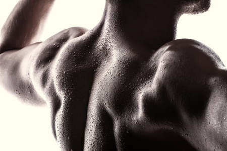 muscle boy: Handsome athlete on a white background Stock Photo