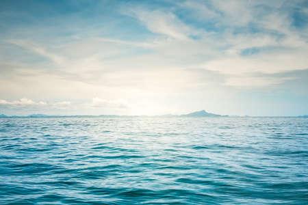 horizon reflection: Blue sunny sea and cloudy blue sky