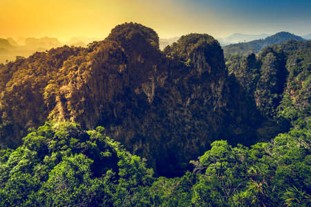 Mountains with green forest landscape in sunset time. Thailand photo