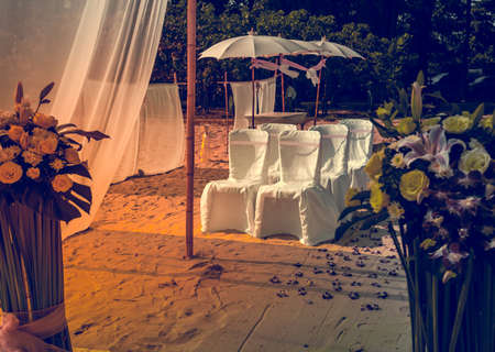 Flower decoration at the beach wedding venue photo
