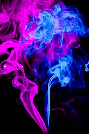 Mistery beautiful smoke on the black background photo