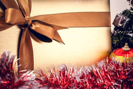 Christmas gift box with golden ribbon photo