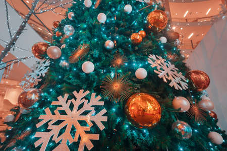 Shopping mall interior decorated with christmas trees photo