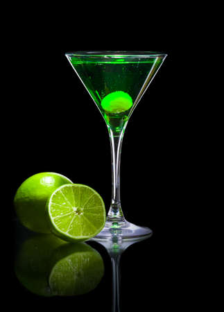 green and black: colourful coctail on the black background