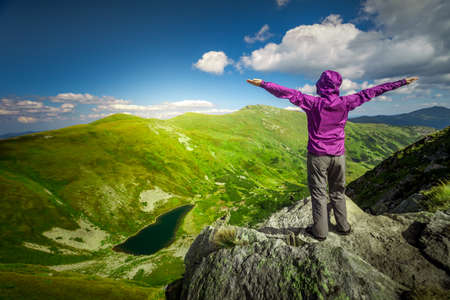 Woman standing on top of a mountain. Carpathians, Ukraine photo