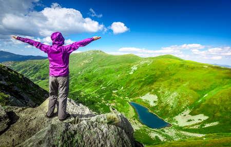 Woman standing on top of a mountain. Carpathians, Ukraine Stock Photo