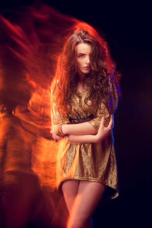 Mixed light fashion portrait of young attractive woman photo