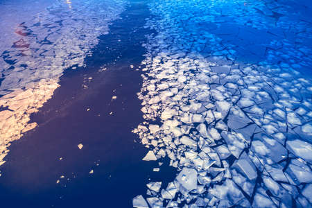 Crashed ice on the river surface. Abstract background photo