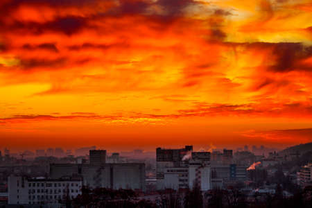 peaking: Orange sunset and cloud over cityscape Kiev, Ukraine, Europe