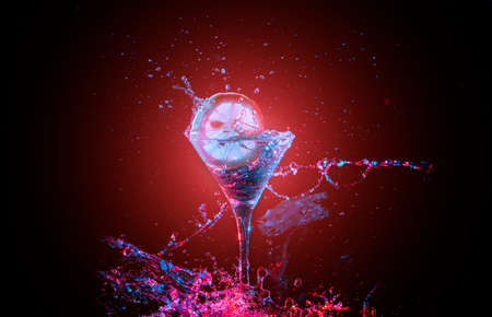 Bright cocktail with lemon and splashing water  on the red background. Party club entertainment. Mixed light