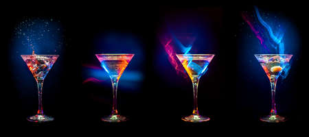 drinks on bar: Bright  cocktails in glasses   isolated on the black