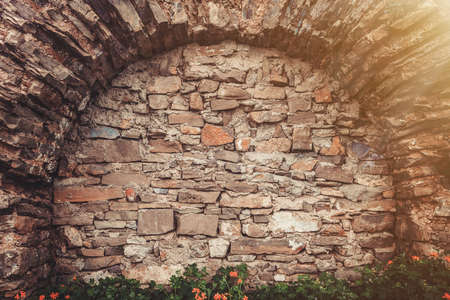 arched: Ancient stone wall with arched niche