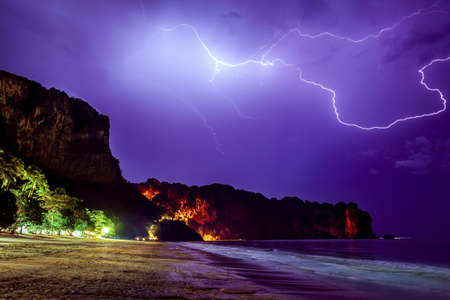 lightning storm: Lightning flashes across the night sky on beach in Thailand, Krabi province Stock Photo