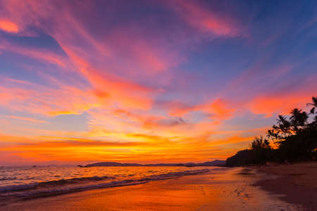 tropical paradise: landscape of tropical beach and colorful sky at sunset in Krabi province, Thailand Stock Photo