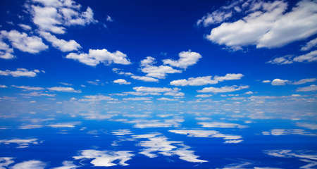 reflected: natural landscape with blue sky and clouds reflected in water